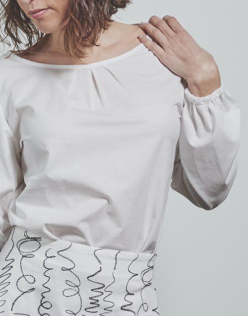detalle blusa blanca